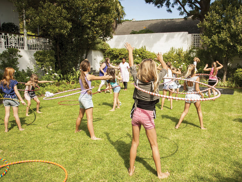 kids playing with hula hoops at birthday party
