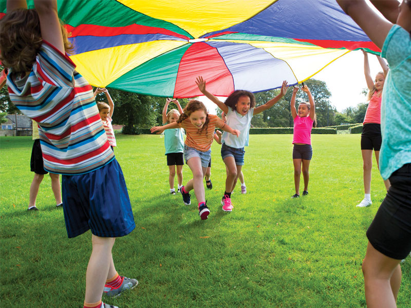 kids playing parachute game at birthday party